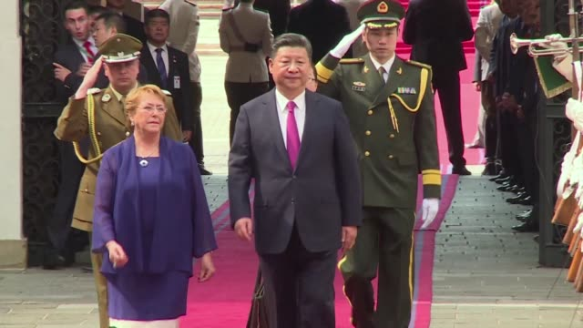 Chilean president Michelle Bachelet receives her Chinese counterpart President Xi Jinping at La Moneda presidential palace on Tuesday in Santiago