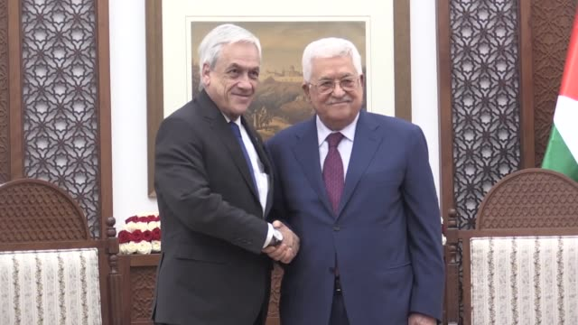 vídeos de stock, filmes e b-roll de chilean president sebastian pinera is welcomed by palestinian president mahmoud abbas with an official ceremony prior to a meeting in ramallah west... - ramallah