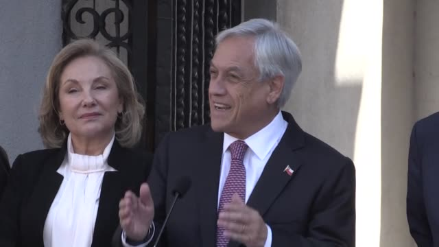 chilean president sebastian pinera reacts avec the international court of justice states that chile has no obligation to negotiate an access to the... - international court of justice stock videos and b-roll footage