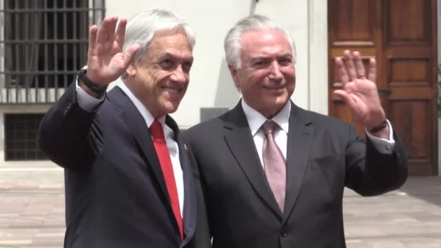 Chilean President Sebastian Pinera receives his Brazilian counterpart Michel Temer in the presidential palace of La Moneda for a bilateral meeting...