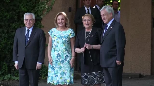 chile's outgoing president michelle bachelet visits the freshly elected successor and former president sebastian pinera at his house on monday... - nachfolger stock-videos und b-roll-filmmaterial