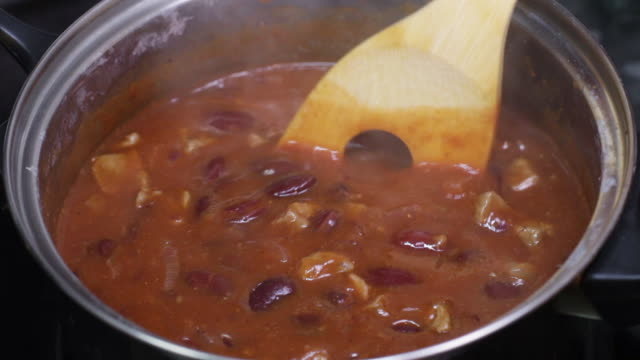 chili con carne cooking - bean stock videos & royalty-free footage