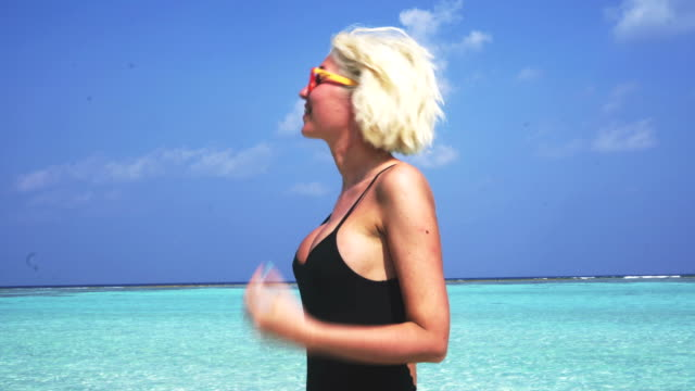 chill out in shallow water on maldives - tan stock videos and b-roll footage