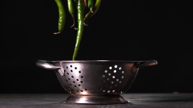 Chilli's on fire falling into a colander