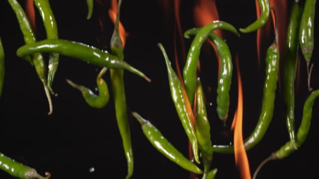 chilli's on fire falling through frame - peperone video stock e b–roll