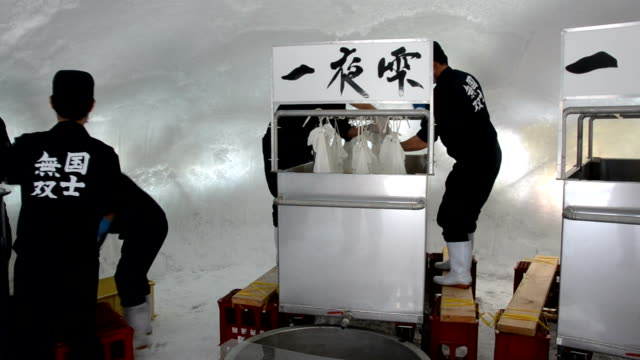 chilly ice dome is a most unthinkable but actually one of best places to use for part of japanese sake brewing, according to a local brewery here in... - asahikawa stock videos & royalty-free footage