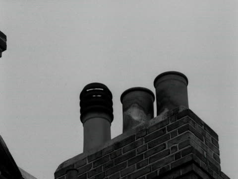 chimney sweep's brush pops out of a chimney pot sending soot up into the sky. - soot stock videos & royalty-free footage