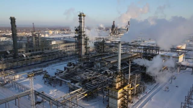 Chimneys emit vapor at the Novokuibyshevsk oil refinery plant operated by Rosneft PJSC in Novokuibyshevsk Samara region Russia on Thursday Dec 22 2016