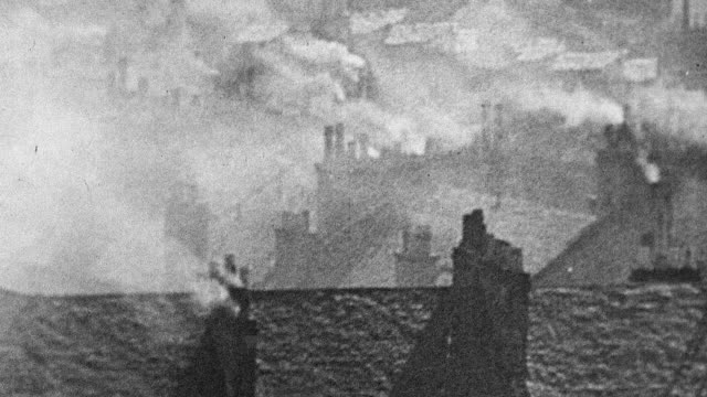 vidéos et rushes de 1944 montage chimneys filling air with smoke in industrialized area / scotland, united kingdom - smog