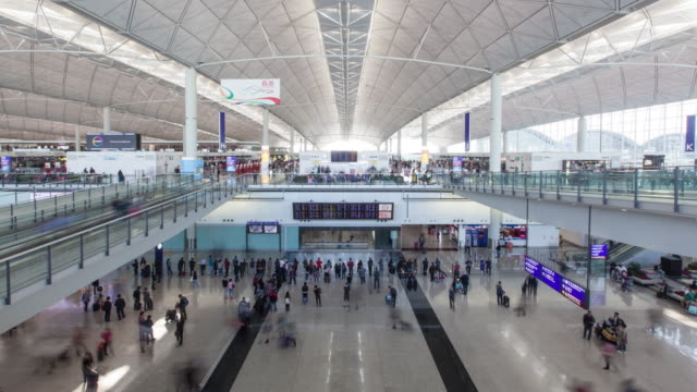 China , 4k, Time Lapse , Hong Kong Airport Terminal , the hall between the shuttle crowd