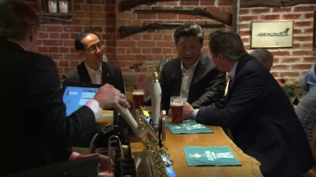 China allows Xi Jinping to be 'president for life' LIB / Buckinghamshire Cadsden The Plough INT Xi Jinping and David Cameron having a pint at the bar...