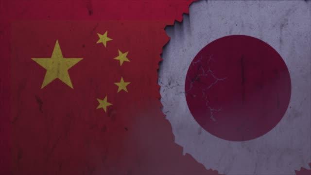 石壁ストックビデオに中国と日本の旗 - 外交点の映像素材/bロール