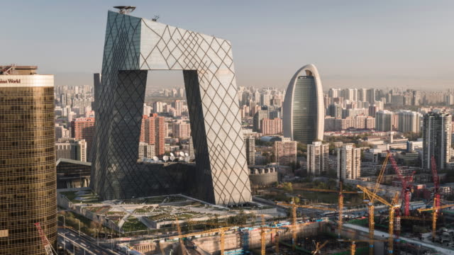 china, beijing, aerial view of construction site, in front of the cctv tower - beijing stock videos & royalty-free footage