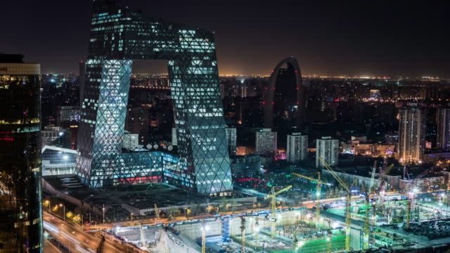 China, Beijing, CCTV tower with working construction site in foreground