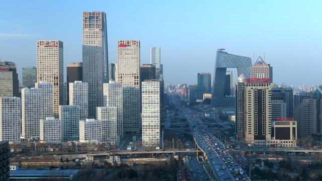 China, Beijing, Central Business District, elevated view of traffic passing new skyscrappers