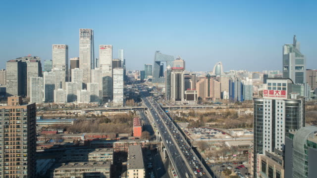 china, beijing, central business district, elevated view of traffic passing new skyscrappers - time lapse - beijing stock videos & royalty-free footage