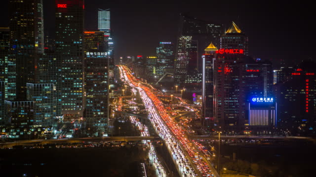 China, Beijing, Central Business District, elevated view of traffic passing new skyscrappers - Time lapse