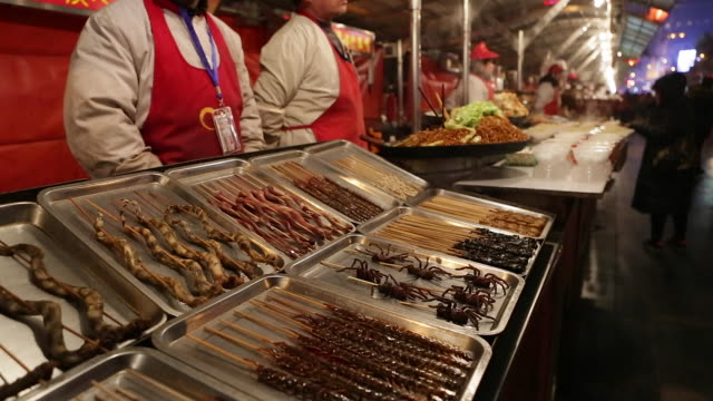 china, beijing, food stalls in wanfujing dajie street, beijing's main shopping street at night - gourmet stock videos & royalty-free footage