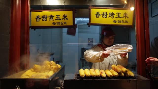 China, Beijing, Food stalls in Wanfujing Dajie Street, Beijing's main shopping street at night