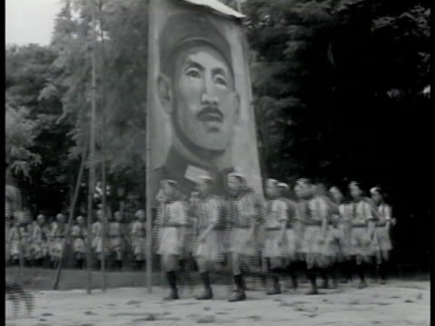 scouts china boy scouts in uniform marching by banner of chiang kaishek ms boys standing saluting w/ three finger scout salute girl scouts in uniform... - chiang kai shek stock-videos und b-roll-filmmaterial