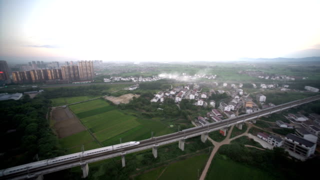 china bullet train on move in fuzhou city aerial view - railings stock videos & royalty-free footage