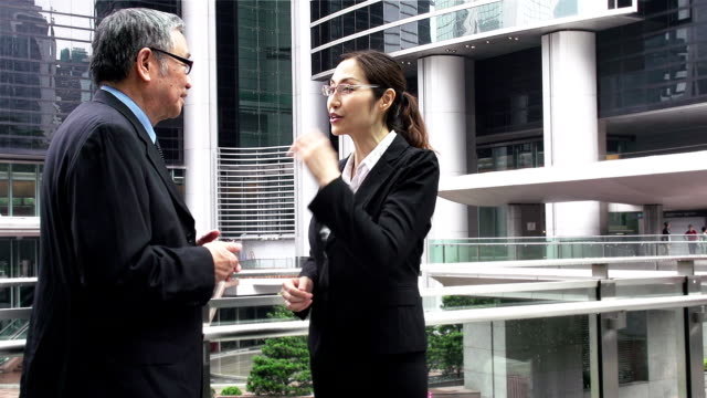 china business people talking - central district hong kong stock videos and b-roll footage