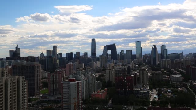china central television headquarters amid the beijing skyline at central business district on june 12, 2015 in beijing, china. - beijing stock videos & royalty-free footage