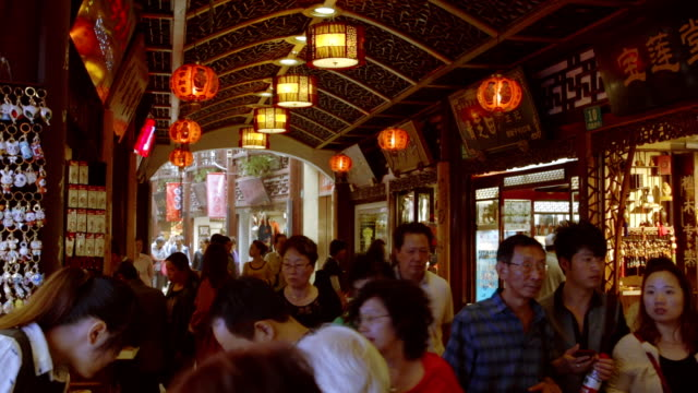 china cowded yuyuan gardens shopping area - shanghai stock videos & royalty-free footage