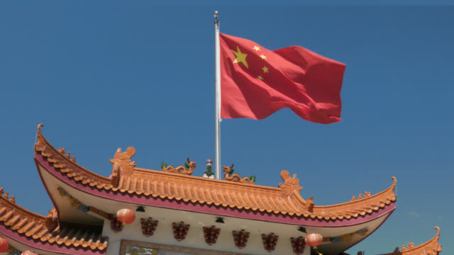 china flag flying - chinese flag stock videos & royalty-free footage