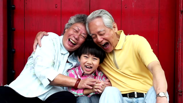 China Grandparents and grandson Lauighing