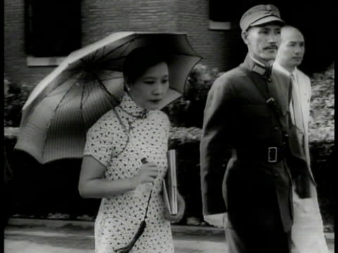 china imperial building. general chiang kai-shek in uniform walking w/ wife mayling soong holding parasol. kai-shek holding china flag bowing to... - 1898 stock videos & royalty-free footage