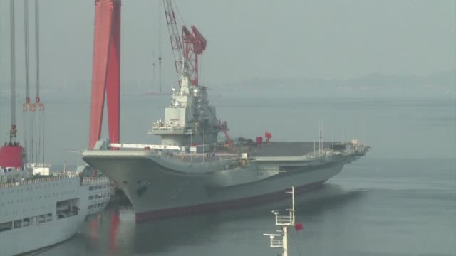 china is building its second aircraft carrier the defence ministry says as beijing expands its naval capabilities amid maritime disputes with... - china east asia stock videos & royalty-free footage