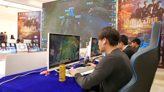 china is expected to fuel the growth rate of digital games market because the increasing disposable income allows more young people to spend more... - contestant stock videos & royalty-free footage