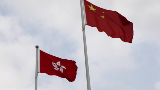 china national flag and hong kong banner,china - hong kong flag stock videos & royalty-free footage