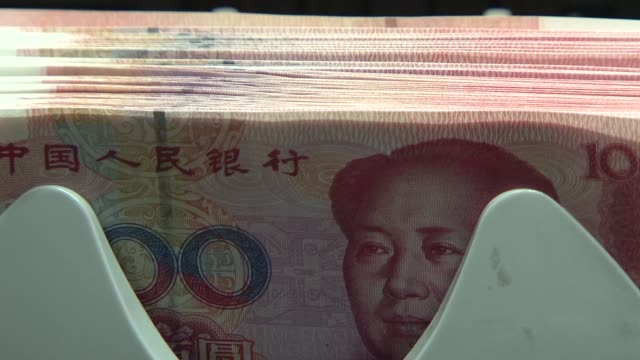 stockvideo's en b-roll-footage met china on tuesday pledged to tighten efforts to stem the flow of speculative money into the country after criticising the us federal reserve's... - meer dan 50 seconden