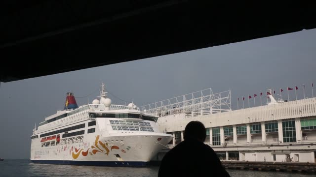 china, on wednesday, nov 19 view of the star pisces moored at ocean terminal in hong kong, china, a silhouette of a man viewing the star pisces... - cruising video stock e b–roll