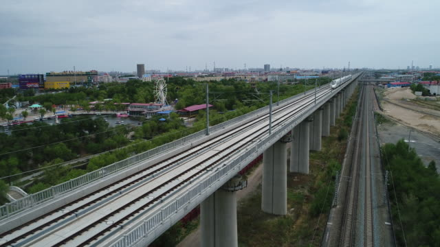 china railway high speed train runs on bridge on may 20, 2017 in daqing, china. daqing is one of the most important oil city in china. - high speed train stock videos & royalty-free footage