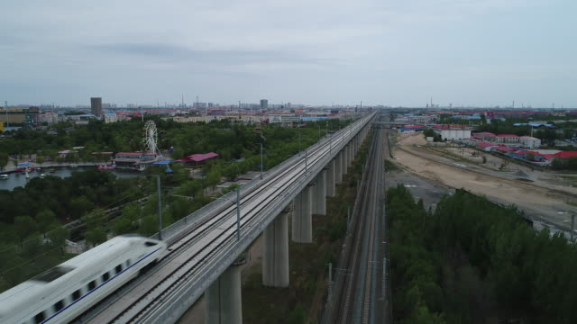 china railway high speed train runs on bridge on may 20 2017 in daqing china daqing is one of the most important oil city in china - high speed train stock videos & royalty-free footage