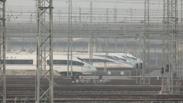 china railway high-speed trains, operated by china railway corp., sit in a train yard on the outskirts of shanghai, china, on thursday, feb. 8... - high speed train stock videos & royalty-free footage