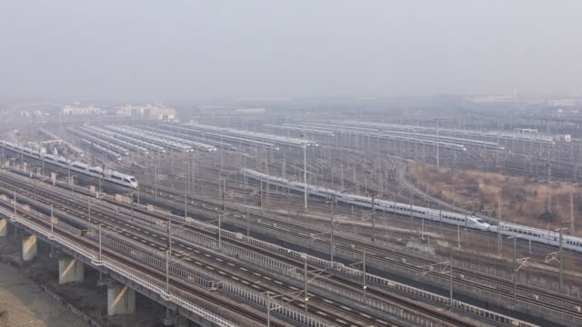 China Railway Highspeed trains operated by China Railway Corp sit in a train yard shrouded in haze on the outskirts of Shanghai China on Thursday Feb...