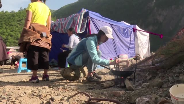 china ramps up its response to an earthquake that killed 19 people and injured hundreds sending supplies and personnel into the mountainous zone as... - rescue worker stock videos & royalty-free footage