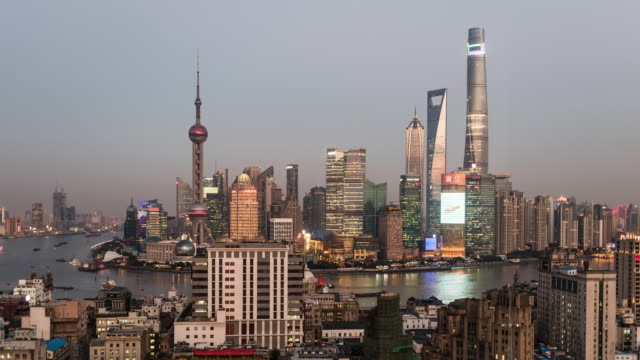 china, shanghai skyline at dusk, showing shanghai tower with special light show - 4k resolution stock videos & royalty-free footage