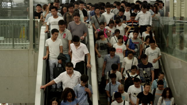 china subway : people get off on an escalator - rolltreppe stock-videos und b-roll-filmmaterial