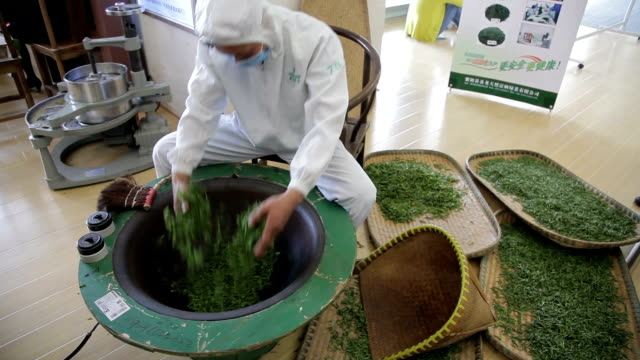 china, tea production process - drying stock videos & royalty-free footage