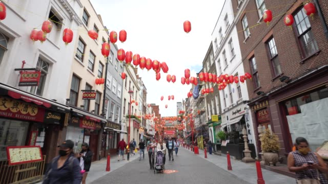 china town on june 28th more retailers are reopening with social distancing measures after being shuttered for months due to the covid-19 pandemic.... - chinatown stock videos & royalty-free footage