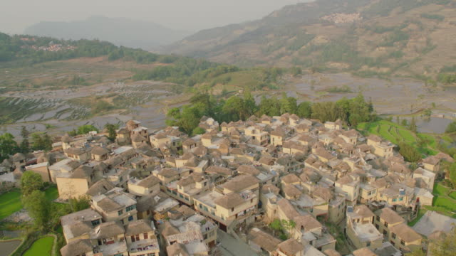 china: village surrounded by rice paddies, close up - yunnan province stock videos and b-roll footage