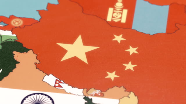 china with national flag on world map - china east asia stock videos & royalty-free footage