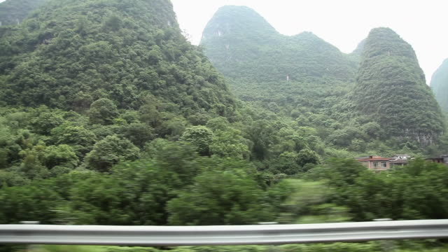 China, yangshuo, karst landscape viewed from moving transport