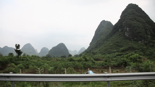 China, yangshuo, landscape viewed from moving transport