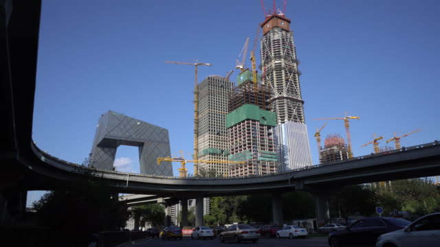 china zun to be the headquarters of citic group is a skyscraper under construction in the central business district of beijing / it is named after... - tall high stock videos and b-roll footage